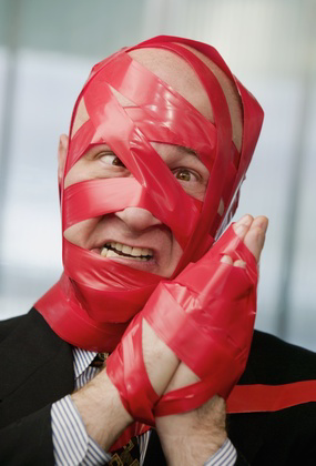 Office Man Covered In Red Tape